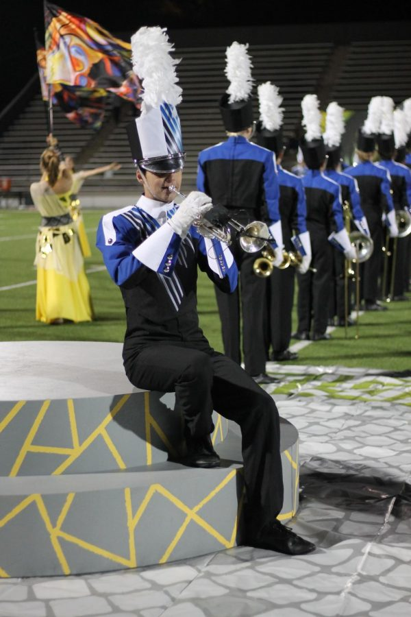 Senior Joe Roddy performs his trumpet solo  at the band's last halftime performance. Photo by Anna McClellan.