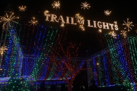 "In this photo you see the entrance to the Trail Of Lights. The entrance is one big tunnel full of colorful lights. Elizabeth Carson, a mom of two, was going through the tunnel. ""This is probably my favorite part of the whole trail because it's so colorful and just a fun experience to walk through,"" Carson said."