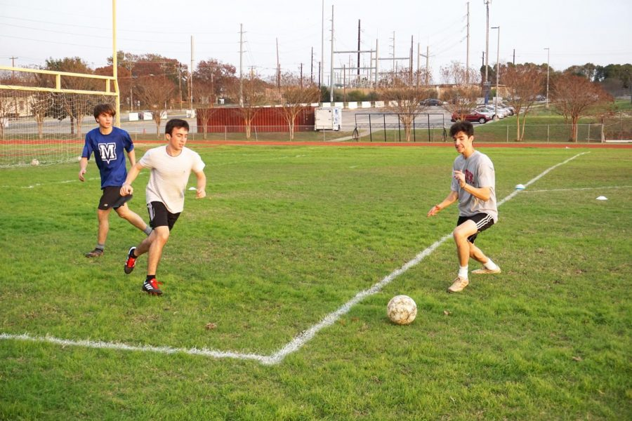 Senior Jimmy Walker makes a break for the goal at soccer tryouts on Dec. 9. Photo by Thomas Melina Raab.