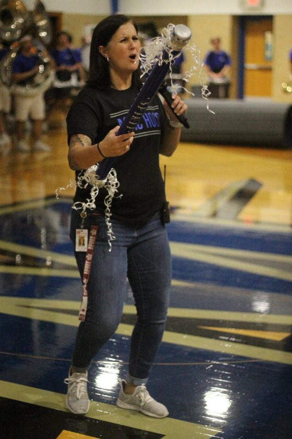 Principal Hosack awards the spirit stick to the senior class at the homecoming pep rally on Sept. 13. Photo by Anna McClellan.