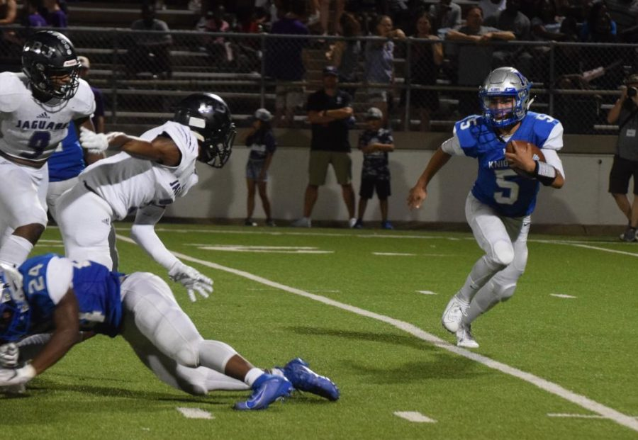 ON TO THE NEXT ONE: Sophomore Jaxon Rosales doubles back to get around LBJ defender in the last quarter of the game Thursday night, Sept. 19. at House Park Photo by Caleb Melville.