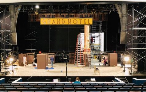 WORK IN PROGRESS: After hanging the Grand Hotel sign, the crew works on assembling the 12 columns that weave throughout the stage. Photo and caption by Ella Rosenblatt.