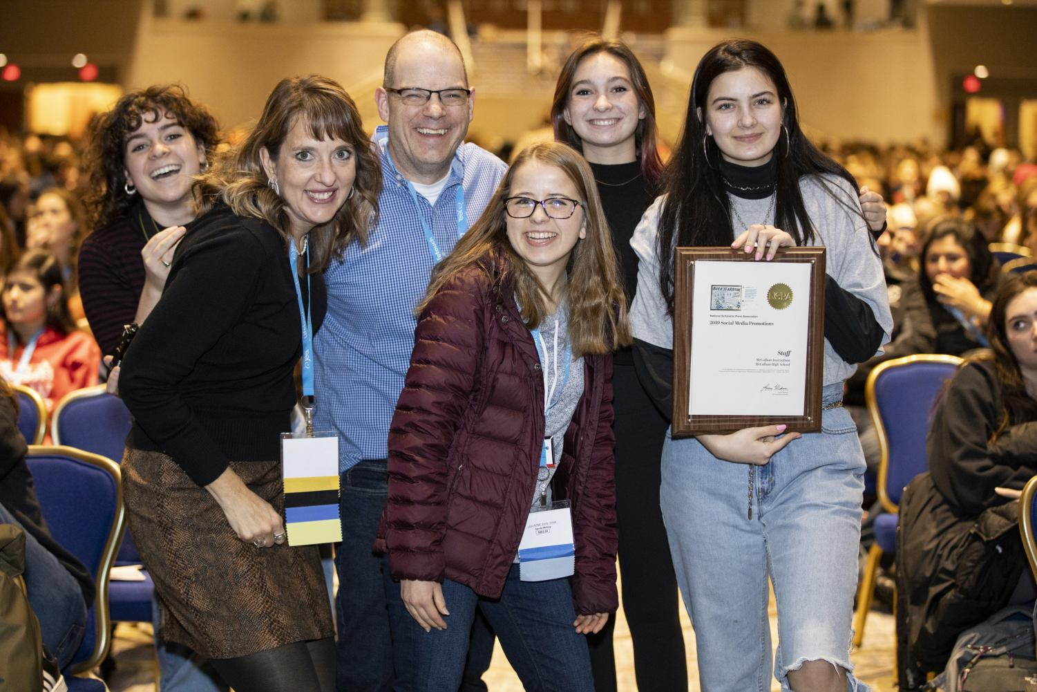 Junior Shield visuals editor and social media coordinator Bella Russo, NSPA board member and ILPC director Jeanne Acton, adviser Dave Winter and seniors, Shield co-editor in chief Kristen Tibbetts, Knight editor in chief Mira MacLaurin and Shield copy editor Alex Dowd, pose with the NSPA Best of Use of Social Media Promotion, one of two first place national awards the MacJournalism social media accounts earned at the DC convention. The other first place award was for best reporting. Photo by Mitchell Franz/NSPA.