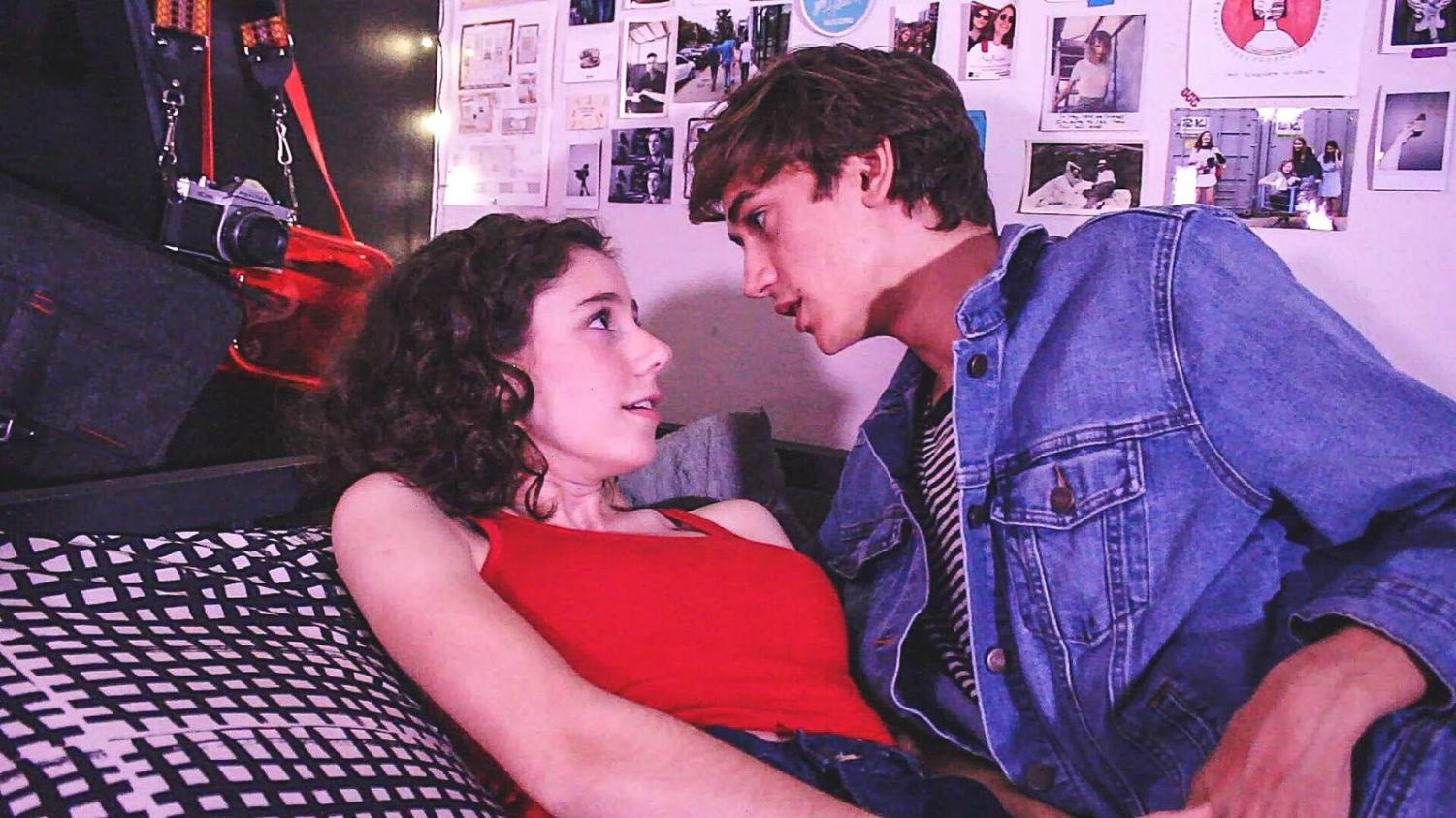 """MALICIOUS MISCONDUCT: Eyes aggressively locked with each other, Ryan (senior Edward Fotinos) holds down Veronica (Austin High junior Katherine Holmes) in Rotten's third scene. """"It's interesting to play a character like that where you can just kind of really be bad without consequence and truly believe what you're doing is right,"""" Fotinos said. """"So as much as it is kind of terrible to say, I was a little excited."""" Still capture of video by Bella Rothenflue."""