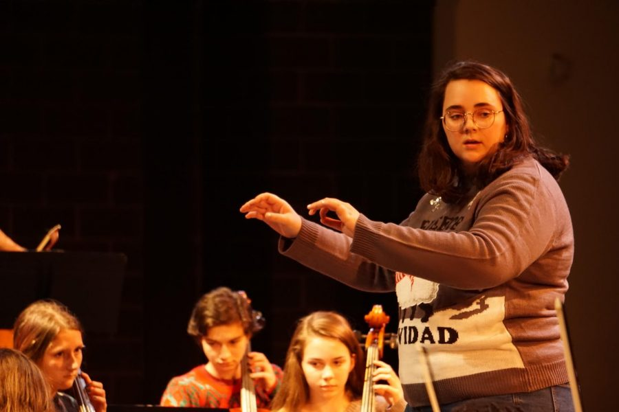 """lder conducts a piece with the orchestra during the program's holiday concert on Dec. 17 in the MAC. Elder feels that they were successful, particularly because the time restraint didn't stop them from organizing and preparing the entire event. """"I think we did well, especially considering that we didn't have a lot of time to learn the pieces we played,"""" she said. """"I learned that we can work as a team to put a concert together in a short amount of time."""" Photo by Samantha Powers."""