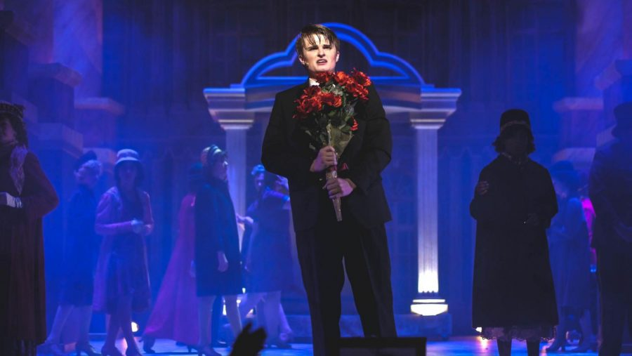 """TRAIN TO NOWHERE: Junior Corin Vandenburg, as Baron Felix Von Gaigern, performs the heartbreaking love song Elizaveta at the Station. Behind him, the ensemble moves in slow motion to help paint the picture of a busy train station. """"During this scene, the Baron is reliving his life and realizing how much he regrets not doing, """" said Vandenburg. """"It was a lot of fun to think about what it would be like in that situation."""" Photo by Angus Sewell McCann."""