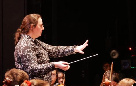 """CONDUCTOR OF THIS TRAIN: Assistant orchestra director Erika Elder conducts the non-varsity full orchestra before its Pre-UIL concert, on Tuesday Feb. 11. The performance helped the orchestra stay on track with its weekly Tuesday rehearsals. """"I thought we did pretty well overall,"""