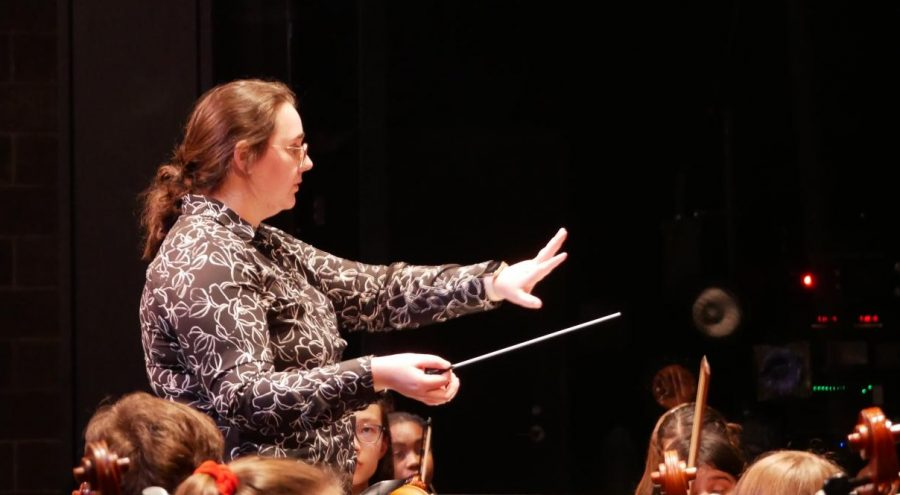 "CONDUCTOR OF THIS TRAIN: Assistant orchestra director Erika Elder conducts the non-varsity full orchestra before its Pre-UIL concert, on Tuesday Feb. 11. The performance helped the orchestra stay on track with its weekly Tuesday rehearsals. ""I thought we did pretty well overall,"
