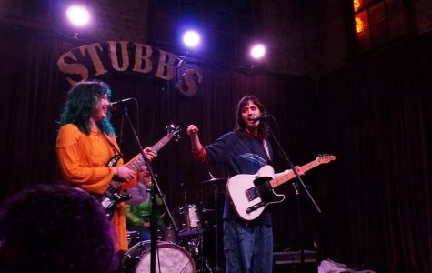 "DYNAMIC DUO: Seniors Louisa Najar and Abby Green perform at Stubb's Bar-B-Q on Tuesday, Feb. 11. The two girls, along with senior Ruby Henson, are the members of a band they named Pit Punch. ""We started to talk about making music during the summer of 2019,"" Green said. ""When we write songs, inspiration comes from the mood we are in and the vibe of the day."
