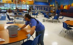 GUARDIANS OF OUR GALAXY: The custodial staff begins a deep clean of the Mac campus on Friday March 13 by wiping down the tables in the cafeteria. Originally the deep clean was to take place during spring break, but because of todays districtwide cancellation, administrators decided to start it today instead. Assistant principal Gabe Reyes urged all teachers to make their classrooms ready for the deep clean by 10 a.m. Photo by Dave Winter.