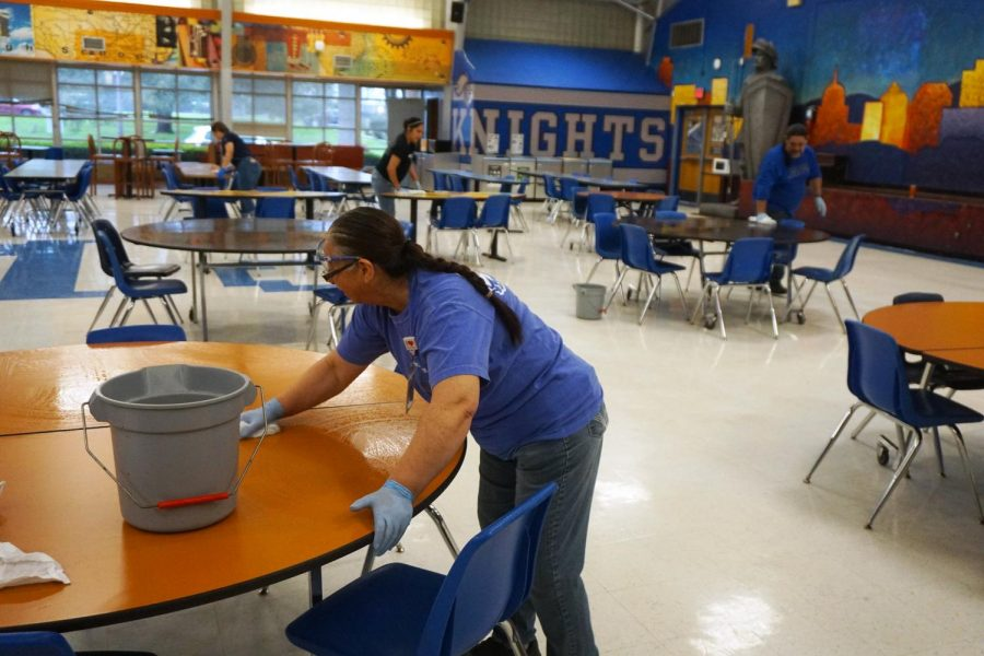 GUARDIANS+OF+OUR+GALAXY%3A+The+custodial+staff+begins+a+deep+clean+of+the+Mac+campus+on+Friday+March+13+by+wiping+down+the+tables+in+the+cafeteria.+Originally+the+deep+clean+was+to+take+place+during+spring+break%2C+but+because+of+today%27s+districtwide+cancellation%2C+administrators+decided+to+start+it+today+instead.+Assistant+principal+Gabe+Reyes+urged+all+teachers+to+make+their+classrooms+ready+for+the+deep+clean+by+10+a.m.+Photo+by+Dave+Winter.
