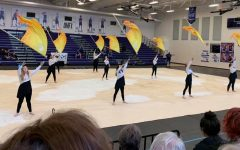 The color guard scored 71.790 to earn seventh place in the Scholastic Regional A division of the Texas Color Guard Circuit competition held this weekend at Cedar Ridge High School in Round Rock. Mac color guard members expressed regret tonight that they would not get the chance to place higher at this weekend's now cancelled area championships.  Photo by Elizabeth Alford.