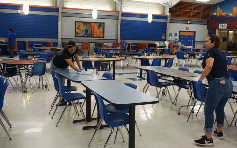 The custodial staff begins a deep clean of the Mac campus on Friday March 13, wiping down the tables in the cafeteria. Originally the deep clean was to take place during spring break, but because of the districtwide cancellation of school on March 13, administrators decided to start the deep clean early. Photo by Dave Winter.