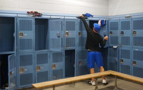 Originally, varsity baseball coach was going to mow the softball field then head to the Leander ISD Tournament with his baseball team, but instead he spent Friday prepping the locker room in the field house for the deep clean originally scheduled for spring break. Photo by Dave Winter.