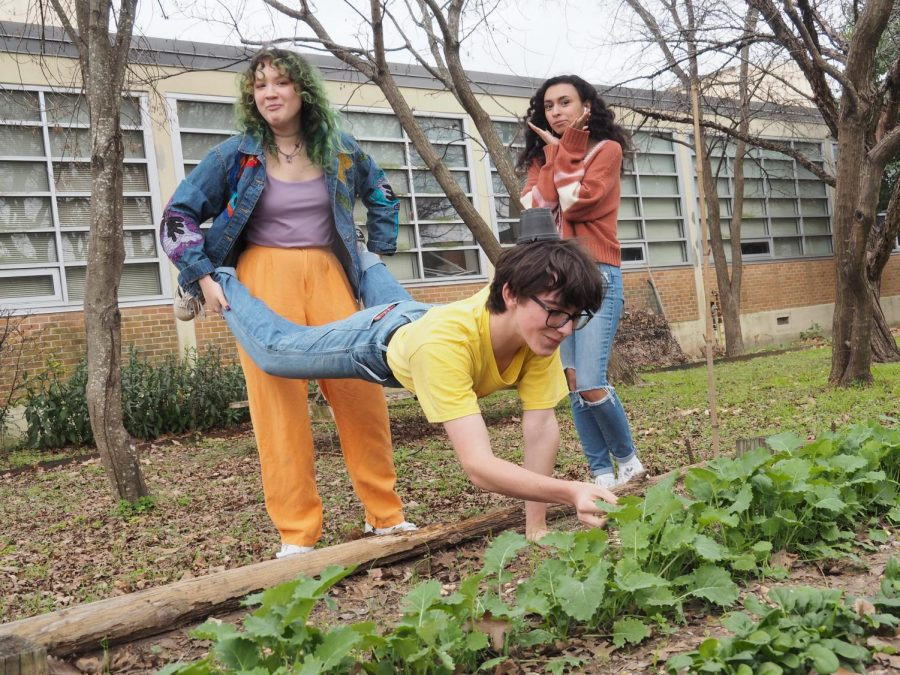 "HEAD OVER HEELS: Louisa Najar, Antonia Ortiz, and Sabri Armani-Khaldi tend the plants in the Naturalist Club. ""He has an eye for aesthetics when it comes to Naturalist Club ventures,"" chemistry teacher and Naturalist Club sponsor, Shelly Pringle said. Photo by Lucy Marco."
