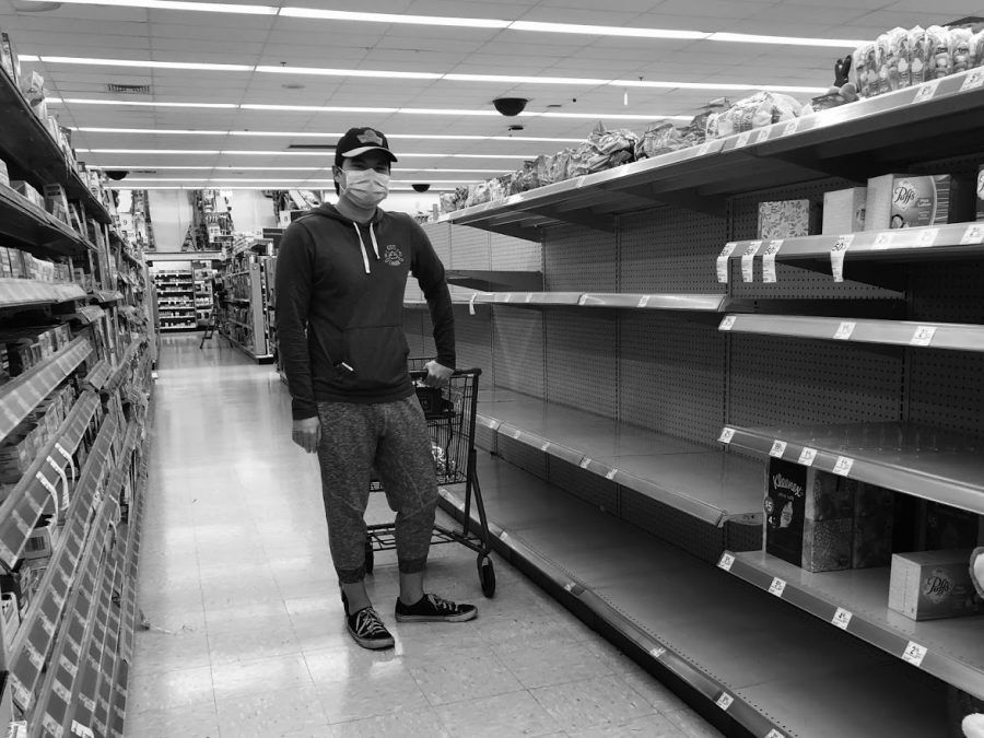 An unidentified Walgreens customer wears a mask for protection, but the shelves where hand cleaners and sanitizers would be has been picked clean. City officials urged Austin residents to avoid hording groceries and buy only what they need. Photo by Risa Darlington-Horta.