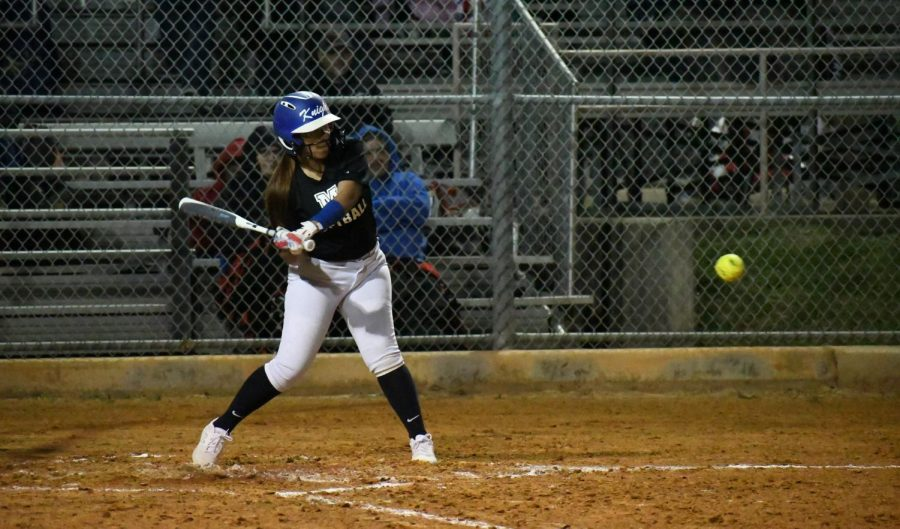 Sophomore Daisy Elizondo locks in on an incoming pitch during the Knights preseason scrimmage against Anderson on  Feb. 4. Photo by Bella Russo.