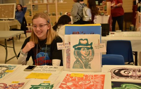 """Senior Gabby Sherwood displays her art at the McCallum Art Fair. The event took place on Dec. 7 and 8, and was a chance for both student and professional artists to sell their work. """"It was my first time participating in the fair of the art,"""" Gabby said. """"My favorite part was getting to see all of the other artists at their booths with their art."""" Photo by Josie Bradsby."""