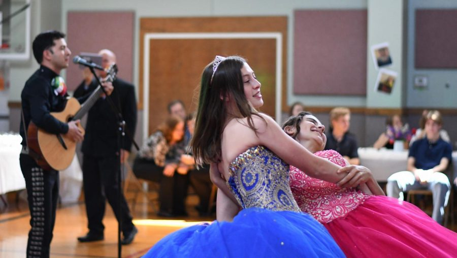 "WARMING UP THE FLOOR:  Sophomores Olivia Capochiano and Nadine Del Gallo were the first to hit the dance floor to the mariachi music of Mac alum Juan Diaz. ""I think most people were too shy [to dance first],"" Capochiano said. ""I wanted to break the tension."" Photo by Bella Russo."