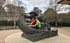 On this trip my two accomplices were Jeremiah Zoric (left) and Seth Wittenbrook (right). They are pictured here enjoying one of the many statues at Everman Park in Abilene Texas. Photo by Max Rhodes