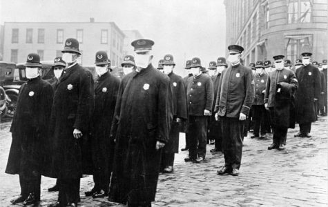 """FROM ONE BATTLE TO THE NEXT: British World War 1 Soldiers wear medical masks amidst the Spanish Influenza pandemic of 1918. Jeremi Suri, a history professor at the University of Texas, explained that influenza reached Europe on a military ship due to World War 1. """"World War 1 was what actually was the main mechanism by which the virus spread,"""" Suri said. """"It started in Kansas, it spread to Europe on a military ship, and then it came back. So, it was spread by the war."""