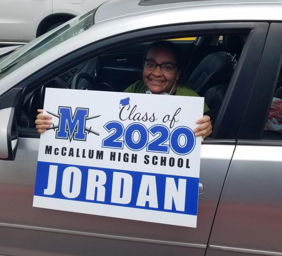 """Jordan Bibby was among the seniors who picked up a yard sign during the curbside pickup on Friday. Bibby said she hopes the virtual graduation ceremony  gives her a sense of closure. """"I feel like these past two months have blurred into one super long day with no real feeling of completion or moving toward a huge goal,"""" Bibby said. """"It feels like nothing is real right now since I can't see, feel, or experience [graduating], so maybe this will be the thing that makes graduation feel like a reality."""" Photo by Elaine Bohls-Graham."""