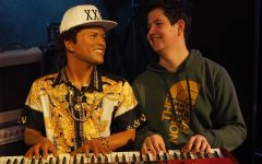 MAKING MUSIC WITH MARS: Junior Luke Lozano laughs as he poses for a photo with a wax figure of Bruno Mars at Madame Toussad's Wax Museum — one of the many excursions made on last year's Nashville piano trip. Lozano stated that the day was filled with lots of silly photos posed with the life-like celebrity figures. Photo by Gregory James.