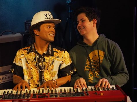 MAKING MUSIC WITH MARS: Junior Luke Lozano laughs as he poses for a photo with a wax figure of Bruno Mars at Madame Toussad