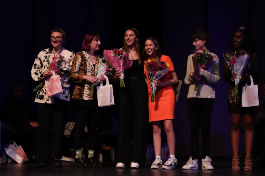 Shaine Rozman (center) accepts flowers from Byron Kingsley (left) and hugs fellow designer Julia Kay Smith (right) after being announced the second place winner of 2020's annual McCallum Fashion Show, Scrapbook. Rozman and Smith also debuted lines earlier in the year at their own benefit fashion show that raised $4,300 for the Girls Empowerment Network. Photo by Risa Darlington-Horta.