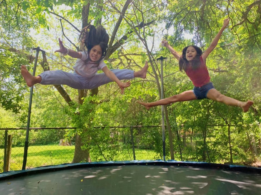 CHEER ON THE TRAMPOLINE: My little sisters are in cheer and their gym is closed so they spend a lot of time on the trampoline practicing their tricks. i often join them and they try and teach me their skills but then we give up and just play games. Photo by Ava Medina.