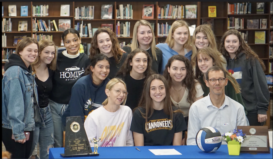 Rozman%E2%80%99s+teammates+gather+for+a+picture++in+the+library+on+Feb.+26+after+watching+her+sign+to+play+for+Pratt%E2%80%99s+volleyball+program.+Varsity+volleyball+coach+Amy+Brodbeck+said+that+Rozman%E2%80%99s++leadership+as+a+team+captain+%E2%80%9Cis+admired+by+not+only+her+coaches+but+her+teammates+as+well.%E2%80%9D+Photo+by+Dave+Winter.