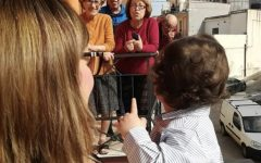 While still practicing social distancing, the neighbors of the author's aunt, Nella Pirruccio, sing