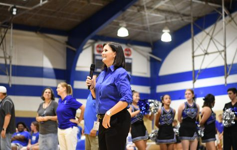 Principal Brandi Hosack takes the mic during the Back to Mac pep rally, an event that she orchestrated very early in her tenure as principal. Photo by Bella Russo.