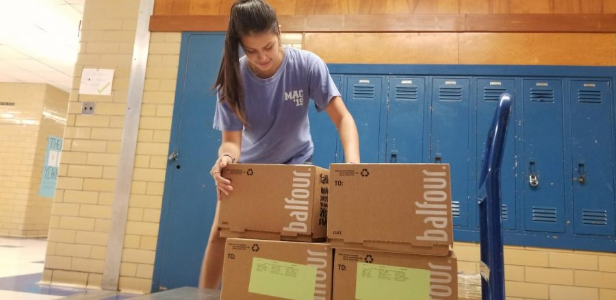 Aranza Sanchez unloads boxes of the 2019 yearbook into Room 134 on May 18, 2019. The 2020 edition of the Knight will arrive and be distributed on Aug. 7.