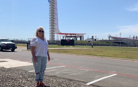 Adamson stands beside the COTA track she drove with her daughter on Mother's Day earlier this year.