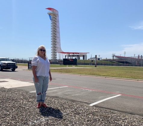 Adamson stands beside the COTA track she drove with her daughter on Mother