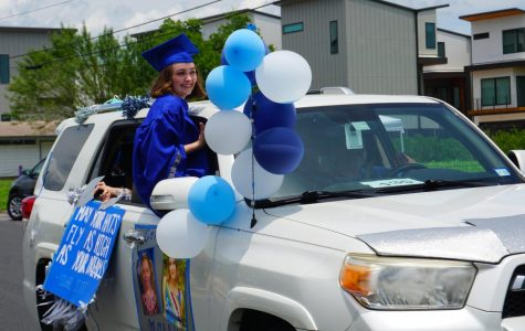 McCallum senior Molly Gardner attends the class of 2020 drive-by graduation parade on May 28. The parade has been one of the few on-campus events that have taken place since COVID-19 prompted the closure of the campus on March 13. Photo by Evelyn Griffin.