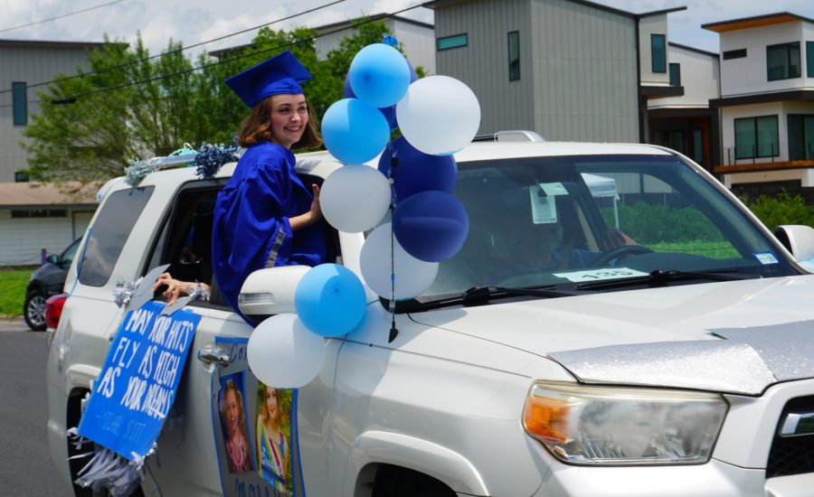 McCallum+senior+Molly+Gardner+attends+the+class+of+2020+drive-by+graduation+parade+on+May+28.+The+parade+has+been+one+of+the+few+on-campus+events+that+have+taken+place+since+COVID-19+prompted+the+closure+of+the+campus+on+March+13.+Photo+by+Evelyn+Griffin.%0A%0A