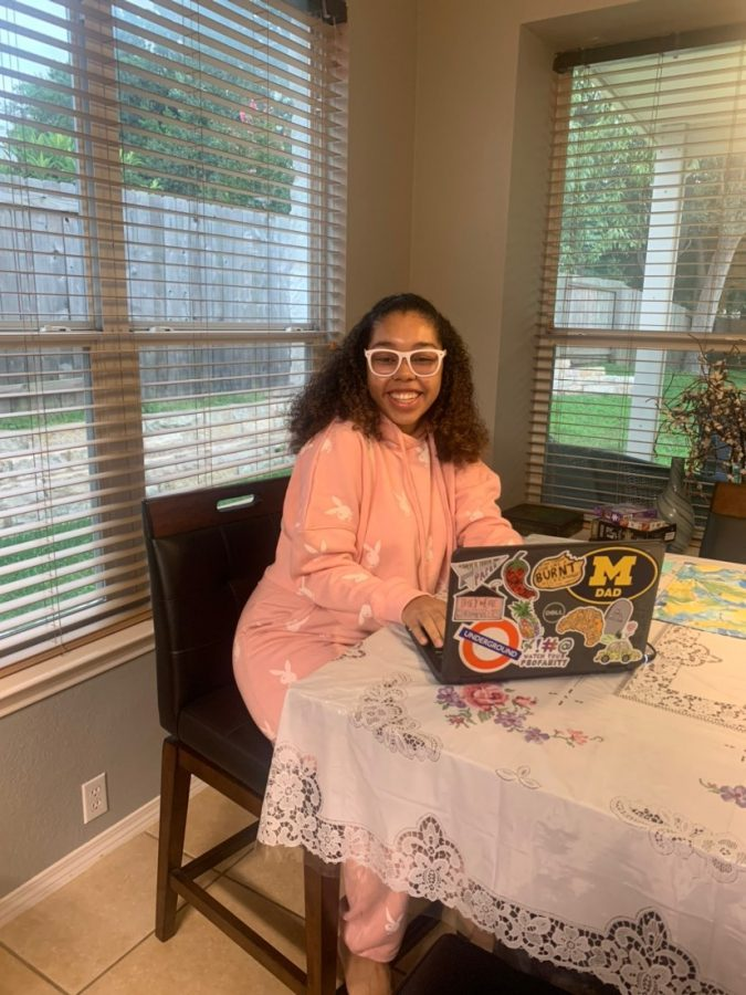 "VIRTUAL VOGUE: Senior Helena Laing poses in her first-day-of-school work space and with her Zoom view fashion. Laing's proud mom, Desiree Lang, saw the opportunity to send in first-day pictures and answered the call. Ms. Lang describes the outfit of choice as ""quarantine chic."" Of Helena's first day, Lang said, ""She thought it went really well and was impressed on how well teachers set it up for them."" Reporting by Alysa Spiro. Caption by Samantha Powers."