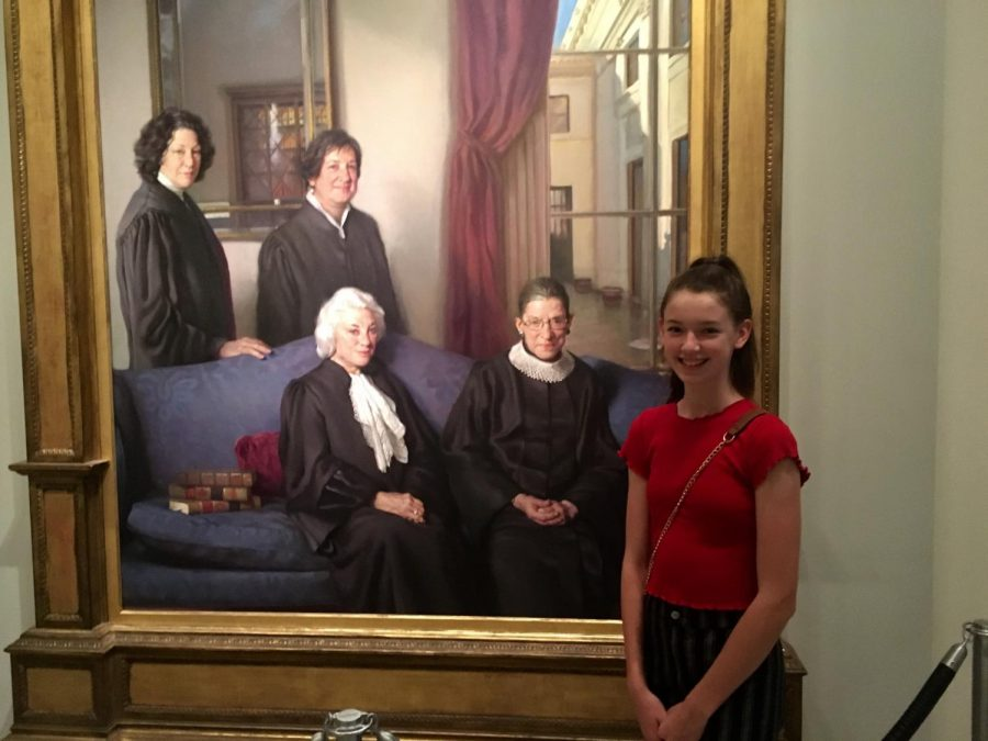 Samantha poses with a portrait of all the female Supreme Court justices at the National Portrait Gallery during her family's visit to Washington DC in the summer of 2018. Samantha hopes to one day join that hall of fame as a woman serving on the highest court in the land alongside her idol, Justice Ginsburg. Photo courtesy of Samantha Powers.