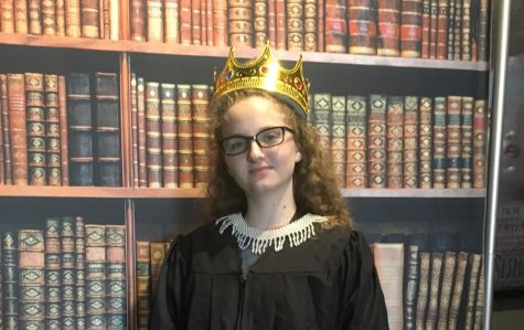 FEELING NOTORIOUS: Dressed in a full-length robe, collar, glasses and of course, crown, Alysa has her picture taken at Austin Film Society