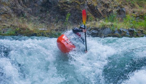 "Alex Tita, a junior at the World Class Kayak Academy, paddles down the lower White Salmon River in Banks, Idaho. ""This is one of our everyday sections,"" Tita said, ""I am taking a boof stroke over Steelhead Falls."" Photo by Kalob Grady."