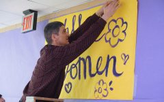 PALS sponsor Richard Cowles puts the finishing touches on the Wall of Notable Women in preparation for the school's observation of International Women's Week on Feb. 28. The school celebrated the international holiday the first week of March and promptly shut down the following week when the first COVID cases were discovered in Austin on March 13. Cowles and his colleagues have not worked on campus since March 12, but they will return to their classrooms on Monday unless they have a COVID-19 medical accommodation to stay home.