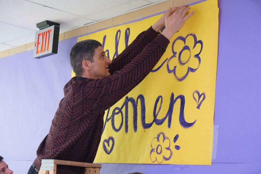 PALS sponsor Richard Cowles puts the finishing touches on the Wall of Notable Women in preparation for the schools observation of International Womens Week on Feb. 28. The school celebrated the international holiday the first week of March and promptly shut down the following week when the first COVID cases were discovered in Austin on March 13. Cowles and his colleagues have not worked on campus since March 12, but they will return to their classrooms on Monday unless they have a COVID-19 medical accommodation to stay home.