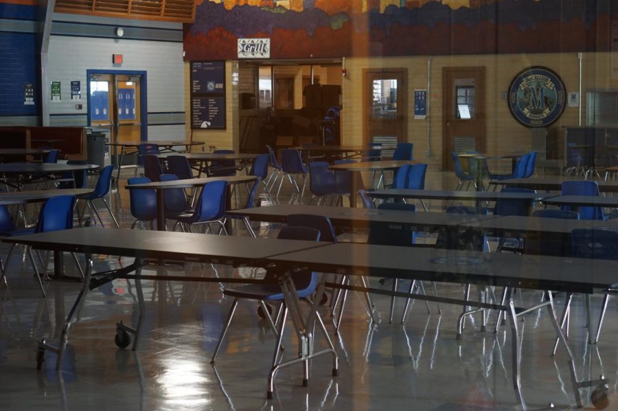 The McCallum cafeteria sits empty on the Friday to end the first week of school. When pod learning begins, students will eat lunch with their learning groups of 6-9 people with partitions between them to mitigate spread while students take their masks off to eat.