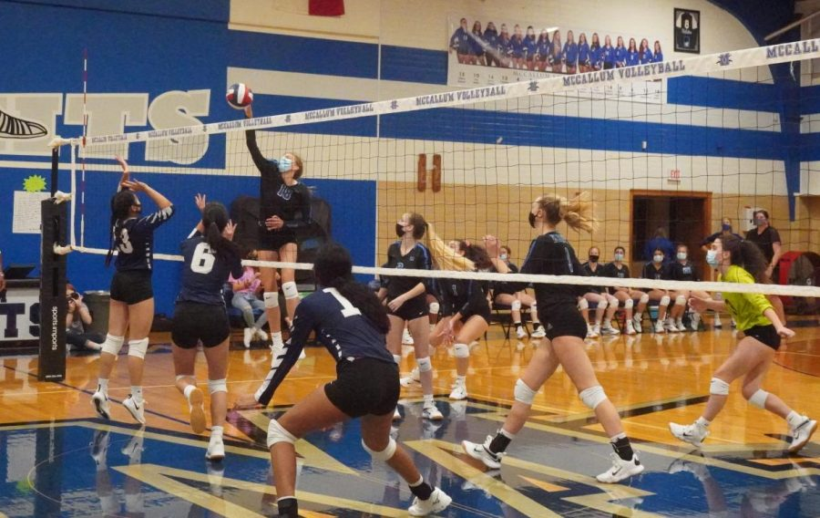 All eyes are on freshman outside hitter Gella Andrew as she delivers a kill attempt during the Knights straight-set home victory over their familiar new foes, the LASA Raptors.