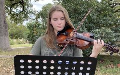 """Freshman Ingrid Smith plays at an outdoor concert today organized by her teacher Laura Poyzer. Smith played a solo piece, accompanied by a quartet that included Poyzer and three other people. Smith said that the outdoor concert was Poyzer's idea because she and her violin students hadn't seen each other since March and could play music together safely outdoors. Smith was one of 12 Mac orchestra violinists named to the TMEA All-Region 18 orchestra a weekend ago.   """"Making region is like validation for all my hard work,"""" Smith told MacJournalism. """"It was a goal of mine to make region even before I got the music in May, and even though I know region will be different this year, I'm proud of myself for achieving my goal, putting in the work, and seeing myself succeed."""""""