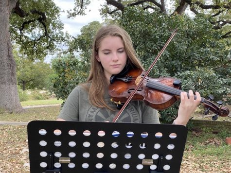 "Freshman Ingrid Smith plays at an outdoor concert today organized by her teacher Laura Poyzer. Smith played a solo piece, accompanied by a quartet that included Poyzer and three other people. Smith said that the outdoor concert was Poyzer's idea because she and her violin students hadn't seen each other since March and could play music together safely outdoors. Smith was one of 12 Mac orchestra violinists named to the TMEA All-Region 18 orchestra a weekend ago.   ""Making region is like validation for all my hard work,"" Smith told MacJournalism. ""It was a goal of mine to make region even before I got the music in May, and even though I know region will be different this year, I'm proud of myself for achieving my goal, putting in the work, and seeing myself succeed."""