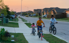 Taking a ride around their neighborhood,  Telvi Altamirano Cancino and her children enjoy their evening family time. Photo courtesy of Altamirano Cancino