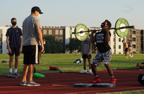 Starting out strong, Coach Webb begins his work at McCallum by helping lead the strength and conditioning training for this year's football players.